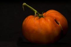Ecologic mature tomato. Isolated in black Stock Photos