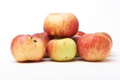 Biological natural apples isolated on white background. Grown without fertilizers and chemistry. Stock Photography