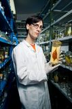 Biologist. Holding fish in formalin stock images