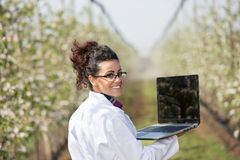Biologist in blossoming orchard Royalty Free Stock Photos