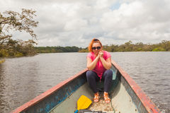 European Woman In Canoe. European Woman Enjoying The Ride In The Canoe On Cuyabeno River, South America stock photos