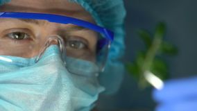 Biologist holding plant sample in forceps, genetic breeding experiment in lab. Stock footage stock video footage