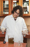 Biologist making experiment. With chemical reaction Royalty Free Stock Photography