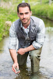 Biologist take a sample in a river in order to do some test Royalty Free Stock Photos