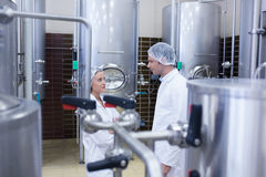 Biologist team talking and wearing hairnet Stock Photography