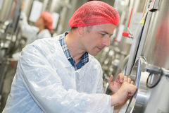 Biologist working in factory. Biologist working in the factory Stock Images