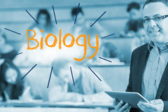 Biology against lecturer standing in front of his class in lecture hall Stock Photos