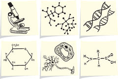 Biology and chemistry icons on yellow memo sticks Royalty Free Stock Photo
