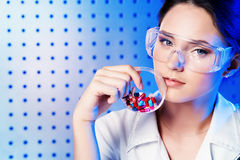 Biology. A doctor is demonstrating drugs Stock Photography