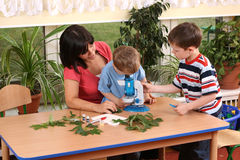 Biology lesson. In preschool - teacher and two boys Royalty Free Stock Photos