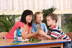 Biology lesson. In preschool - teacher and two boys royalty free stock photography
