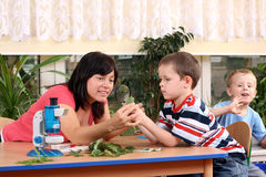 Biology lesson. In preschool - teacher and two boys Royalty Free Stock Images