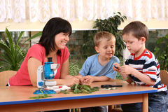Biology lesson. In preschool - teacher and two boys stock photography