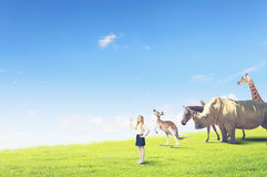 At biology lesson. Cute school girl outdoor with wild animals Royalty Free Stock Photo
