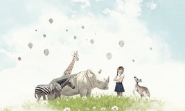 At biology lesson. Cute school girl outdoor with wild animals Stock Photography