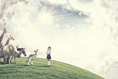 At biology lesson. Cute school girl outdoor with wild animals Royalty Free Stock Images