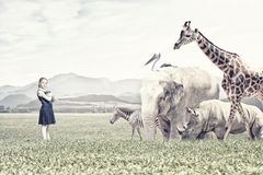 At biology lesson. Cute school girl outdoor with wild animals Stock Image
