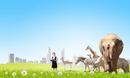 At biology lesson. Cute school girl outdoor with wild animals Royalty Free Stock Photos