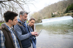 Biology professor with students outdoors Royalty Free Stock Images