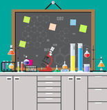 Biology science education equipment. Laboratory equipment, jars, beakers, flasks, microscope, scales, spirit lamp on table. Agenda board. Biology science Stock Photos