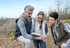 Biology teacher with students outdoors Stock Photos
