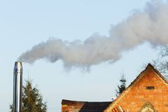 Biomass chimney flue. Domestic biomass chimney emitting smoke and pollutants into the environment royalty free stock images