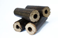 Biomass compressed briquettes Stock Photography