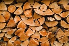 Biomass firewood. A staple of biomass, arranged firewood royalty free stock photography