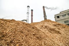 Biomass energy factory and tractor. Biomass is an industry term for getting energy by burning wood, and other organic matter stock photography
