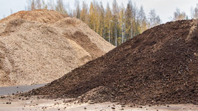 Biomass peat and woodchips. Ready to be used for heating at a biobased energy plant royalty free stock images