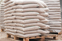 Biomass. Pile of sacks of pellets, which are stacked on pallets Royalty Free Stock Photography