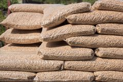 Biomass in plastick bags. Heap of bags ful with wooden biomass royalty free stock image