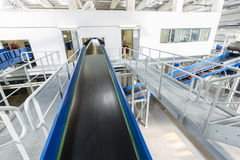 Biomass waste plant conveyer. Inside of a new modern biomass waste plant. As an energy source, biomass is used directly via combustion to produce heat and stock images