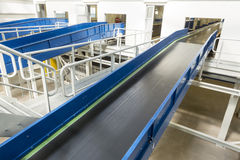 Biomass waste plant conveyer. Inside of a new modern biomass waste plant. As an energy source, biomass is used directly via combustion to produce heat and royalty free stock photography