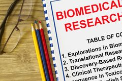 Biomedical research concept. With topcs on a coversheet Stock Image