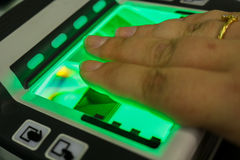 Biometric fingerprint scanner. To apply for a new passport stock image