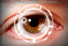 Biometric iris scan security screening. Futuristic biometric scan of the eye iris for security and high level clearance royalty free stock photos