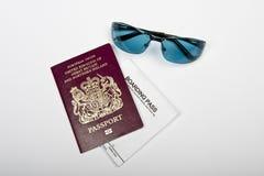 Biometric Passport. Travel essentials, passport, boarding pass and sun glasses Stock Photo
