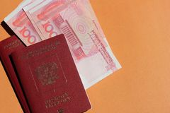 Biometric russian passport and yuan. Tourism, travel and international relations concept stock image
