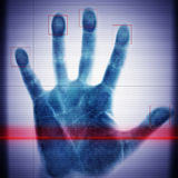 Biometric scanner hand of the man. In the blue toning royalty free stock image