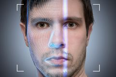 Biometric scanner is scanning face of young man. Artificial intelligence concept. stock photo