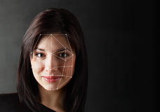 Biometric Verification - Woman Face Detection,. High technology Stock Photo