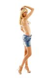 Biondo in pannello esterno e bikini del denim fotografia stock libera da diritti