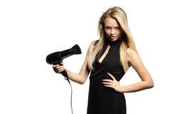 Biondo sexy in vestito nero con hairdryer Fotografia Stock Libera da Diritti