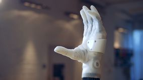 Bionic arm. Real robotic hand. Bionic arm is clenching and unclenching it fingers. 4K stock video