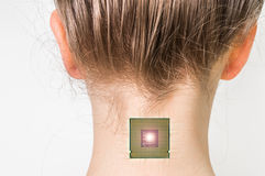 Bionic microchip implant in female human body. Future technology and cybernetics concept royalty free stock image