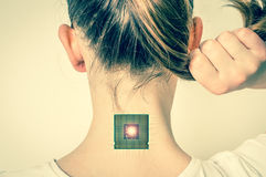 Bionic microchip inside human body - retro style. Bionic microchip inside female human body - future technology and cybernetics concept - retro style stock photo