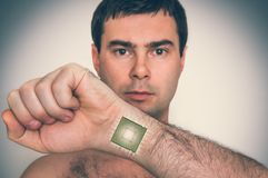 Bionic microchip processor inside male human body. Future technology and cybernetics concept - retro style Stock Photos