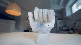 Bionic prosthesis on a table, close up. Modern robotic hand on a table