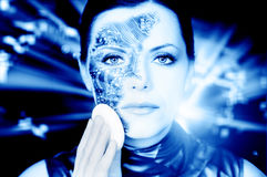 Bionic woman. Removing makeup from her face toned in blue royalty free stock photos